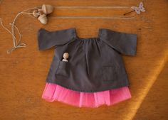 These dolls' clothes could only be French!