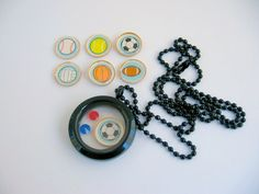 Choose Your Sport and Team Colors Living Locket by Sports Jewelry Studio on Etsy.  Select charms from baseball/softball, football, soccer, tennis, football, volleyball.  Also choose your team crystal colors.  $23.50.  Free gift wrap, quick delivery and 5-star customer service rating on Etsy.  Enter Coupon Code PINS5 to receive 5% Off.  www.etsy.com/shop/sportsjewelrystudio