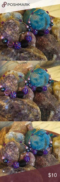 Beautiful beaded hoop earrings! Beautiful beaded hoops in variations of purples, all constructed on memory wire. Jewelry Earrings