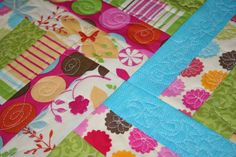 """Picture of Quilt-As-You-Go Quilt """"The basic idea is to quilt all of your layers together, as you are piecing your quilt, so that you are working with smaller, more manageable pieces. There are many different ways you can do this, but the basic idea is all pretty much the same: you stack your pieced block, with batting and backing cut to the same size, sandwich them together and quilt them first, and then actually join blocks together."""""""