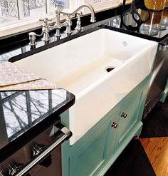 Beautiful farmhouse sink in modern kitchen. I love the aqua sink base with the b. Beautiful farmhouse sink in modern kitchen. I love the aqua sink base with the b. Beautiful farmhouse sink in modern k. House Of Turquoise, Turquoise Accents, Cuisines Design, Küchen Design, Sink Design, Design Ideas, Design Bathroom, New Kitchen, Rustic Kitchen