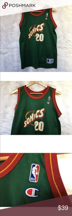 Gary Payton Champion NBA Jersey Seattle SuperSonic Seattle SuperSonics Authentic Made in the USA Champion Jersey Youth Size XL (18-20) Gary Payton #20 He played on the Sonics from 1990-2003 Jersey is in great shape. Measurements Shoulder to Shoulder | 12.5 inches measured from shoulder seam to seam straight across top of jersey Length | 27 inches measured from the top of the shoulder to the bottom of the jersey Chest Circumference | 20 inches x 2 = 40 inches circumference Champion Shirts…