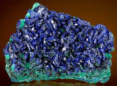 Lustrous bladed crystals of Azurite on Malachite - From the 4160 bench of the Morenci Mine, Greenlee County, Arizona.