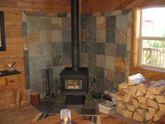 Wood Stove with Slate Surround - Return to Listing - Photo Wood Burning Stove Corner, Wood Stove Surround, Hearth Tiles, Stove Fireplace, Fireplace Ideas, Log Cabin Homes, Cabins, Craftsman Style, Rustic Design