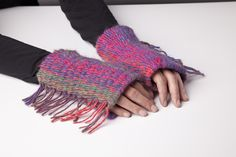 """These colorful fringed fingerless gloves were handmade using the Loopdeloom weaving loom! In addition to making scarves, bags, and cell phone cases, the Loopdeloom can be used to make large scale pieces, too! You can weave items any length, and up to 7"""" wide using one loom. Connect two or more looms together to weave wider items with no seams – genius! Say goodbye to traditional looms, we're putting a new spin on weaving!"""