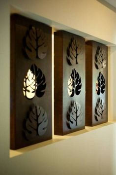 Custom made 'Philodendron Leaf' recessed wall panels. Double-sided screens with Rust finish. Image courtesy of Windemere Homes