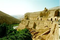 Silk Road:  The Bezeklik Grottoes in the Flaming Mountains near Turfan hang precariously off a cliff above a steep gorge.