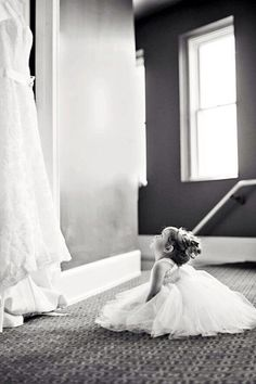 Flower girl looking up at the wedding dress ... I love this