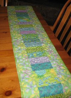 Quilted Table Runner, Turquoise, Green, Yellow & Purple. $50.00, via Etsy.