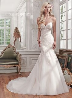 Miranda wedding dress by Maggie Sottero   Gorgeous lace and tulle combine to create this stunning fit and flare wedding dress, accented with shimmering beads and a classic sweetheart neckline. Finished with covered buttons over zipper and inner elastic closure.