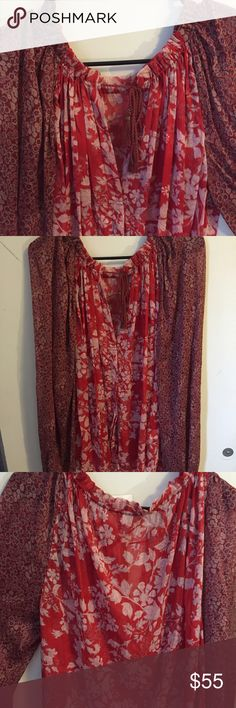 NWT Free People boho peasant top New with tags. Free People boho peasant top. Button-don front, v-neck top, with tie at top. Two flower patterns. Measurements and materials coming soon. Free People Tops Blouses