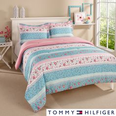 Brighten up your room with this three-piece microfiber comforter set from Tommy Hilfiger. It includes the comforter and two shams for a quick update, and the pastel colors are easy to coordinate with other accessories, sheets, and textiles.