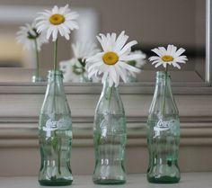 http://www.home-designing.com/wp-content/uploads/2013/03/coke-bottles-white-daisies-trilogy-against-mirror.jpeg