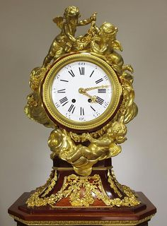 "A Very Fine French 19th Century Louis XVI style ormolu-mounted amaranth, tulipwood, sycamore and parquetry pedestal ""Régulateur de Parquet"" Clock, Attributed to Alfred Emmanuel Louis Beurdeley (French, 1847-1919) After the model attributed to Jean-Henri Riesener. The works by Dufaud, Paris. Circa: 1885."
