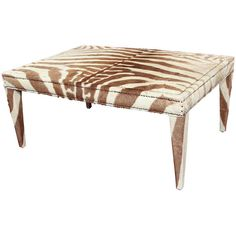 custom coffee/cocktail table upholstered in vintage zebra hide ❤ liked on Polyvore featuring home, furniture, tables, accent tables, vintage home furniture, vintage cocktail table, upholstery furniture, zebra table and nailhead table