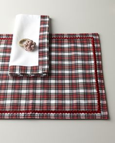 """Juliska Tartan Plaid Placemat  Juliska Tartan Plaid Placemat  Tartan plaid placemat made of cotton. Velvet trim. Spot clean. 19"""" x 14"""". Imported. Napkin and napkin ring not available. About Juliska: Introduced by Dave and Capucine Gooding in 2001, the Juliska collection of elegant European-inspired tableware reflects the couple's appreciation for historical design. Beyond dinnerware, flatware, stemware, and decorative tabletop accessories, today the Juliska collection includes designs for…"""