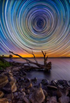 Photographer Lincoln Harrison captures breathtaking images of star trails in the Australian wilderness.