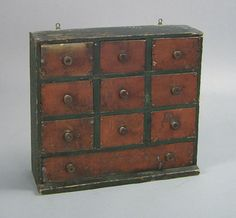 """Painted pine apothecary cabinet, late 19th c., retaining an old red and green painted surface, 18 1/2"""" h., 20 1/2"""" w."""