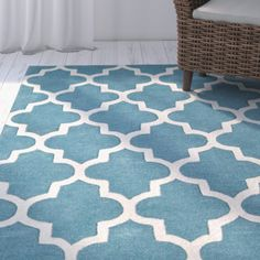 Hand-tufted in India, this wool-mix rug features a quatrefoil motif that's great for adding style to any living room. Teal Rug, Yellow Rug, Teal Area Rug, White Rug, Teal Living Rooms, Living Room Carpet, Rugs In Living Room, Wall Carpet, Carpet Stairs
