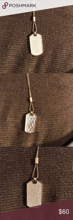 Michael Kors Dog Tag Pendant Necklace This is a beautiful necklace the only major flaw is the blemish on the sides of the necklace. And the necklace is gold tone plated steel/ Mother of Pearl/ Cubic Zirconia Michael Kors Jewelry Necklaces