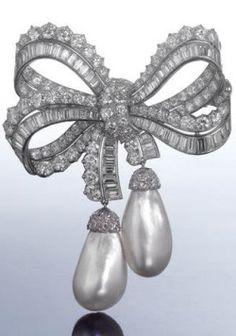 A rare diamond and pearl brooch