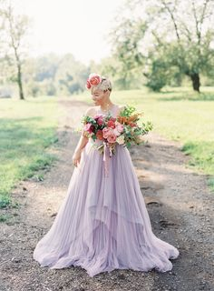 Inspiration Robe du Mariage : Description Lilac layered ModCloth wedding gown: www.stylemepretty… Photography: Michael and Carina – www. Purple Wedding Gown, Lavender Wedding Dress, How To Dress For A Wedding, Colored Wedding Dresses, Tulle Wedding, Wedding Colors, Wedding Styles, Wedding Ideas, Wedding Details