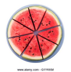 Watermelon sliced, on a blue plate, isolated on white - Stock Image