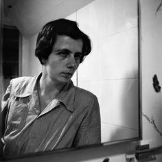 Vivian Maier  Self Portraits in mirrors intrigue me.
