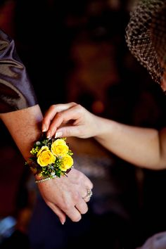 Wrist corsage - yellow sweetheart roses.