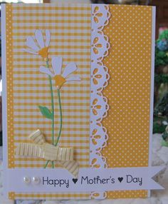 handmade Mother's Day card ... sunny yellow and bright white ... fun mix of gingham and polka dots in same color range ... die cut daisies embedded in the gingham ... luv the Taylored expressions lace chain border die ...