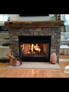 Refinish our mantle and stone the fireplace!! Exactly like this!!