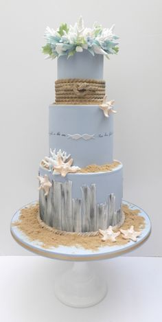 Pretty beach themed wedding cake