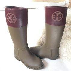 """Tory Burch Tall matte rubber/leather rain boots Tory Burch tall rain boots in a beautiful olive color with chestnut leather tops.  Large Etched Tory Burch logo at top of boot.  These were only worn once and have a couple scuffs on inner side of boot at seen in pic and at the bottom front toe can not see while wearing. Otherwise excellent condition. Measures 16 1/2"""" tall. Top circumference is 15 1/4"""" around.  Absolutely stunning and classy insole measure9"""" long Tory Burch Shoes Winter & Rain…"""