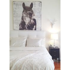 Winter Stallion and Deer head by Z Gallerie. White bedding, DIY tufted headboard and faux fur throw. Create a space you love.