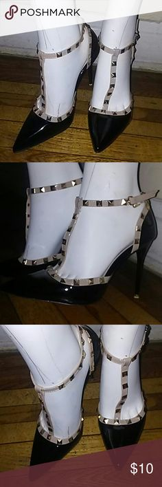 Stylish High heels Black patent leather with nude strap adorn with gold studs..worn once during a fashion show Shoes Heels