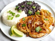 These Cuban-style chicken cutlets are marinated with citrus juices and spices, then seared in a skillet until well browned and juicy. Sautéed onions top them off, and it all comes together quickly and easily.