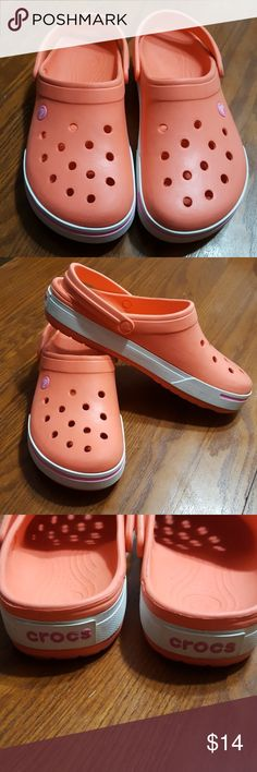 Crocs Orange & Pink Color Combo Lightly worn.  Womens Size 11 Mens Size 9.  No scuffs only some discoloration on the bottoms. CROCS Shoes Sandals