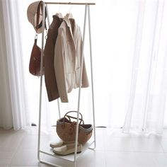 This free standing hanger is a modern + minimalist clothes storage solution and can be placed in the ent… Clothes Storage Solutions, Hanger Rack, Garment Racks, Hanging Organizer, Intelligent Design, Everyday Items, Organizing Your Home, Modern Minimalist, Minimalist Room