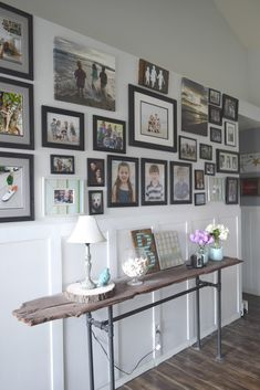 this one, DIY consolde table. Using reclaimed wood and galvanized pipes makes this console table pop nest to the gallery wall and wainscoting.
