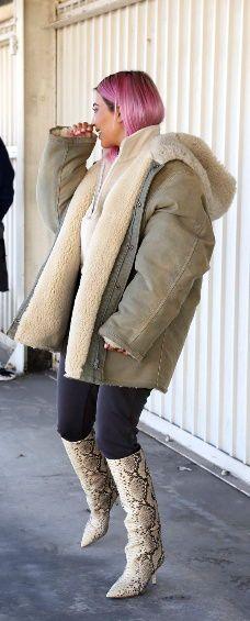 8c0b2d4d73a54 Kim kardashian wearing snake boots yeezy season 6 outfit