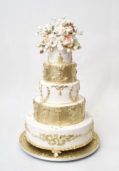 Gorgeous #gold-banded, five-tiered #wedding #cake by the one and only Ron Ben-Israel, via Flickr.