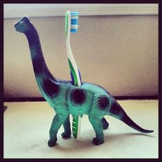 Drill a hole through a plastic toy to make a fun toothbrush holder.
