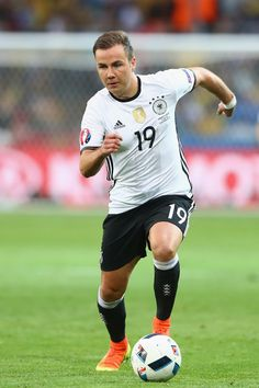 Mario Goetze of Germany runs with the ball during the UEFA EURO 2016 Group C match between Germany and Ukraine at Stade Pierre-Mauroy on June 12, 2016 in Lille, France.