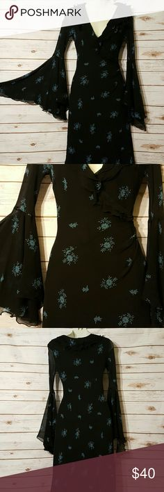 """Express bell sleeve romantic dress Fully lined 100% silk Express dress. Black with blue floral pattern throughout. Sleeves are sheer, tight from shoulder to elbow where they bell out. Tag says 5/6 Bust 36"""" Waist 26"""" Hips 38""""  Length 42"""" Express Dresses Midi"""