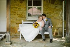 Us! Bride and groom on a bench before the wedding ceremony. Adena Mansion, sunflower bouquet, purple, grey tux Photograph by Ashley West Photography