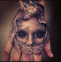 big eyes hand tattoos egodesigns