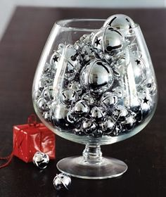 Glass container filled with silver jingle bells makes for great Christmas decor!