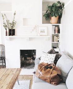 clean and serene. wood, leather, and terra cotta add warmth to living room . home decor