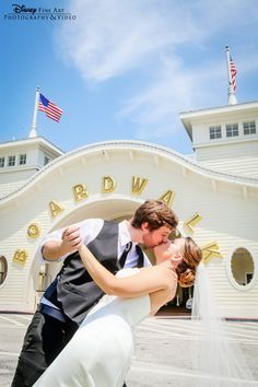 Sharing a kiss in front of Walt Disney World's BoardWalk Inn #BoardWalk #Inn #Disney #wedding