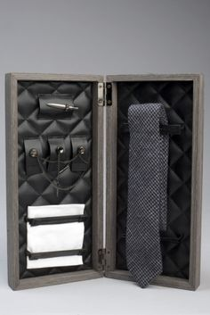 """I have no use for this, but it's a really good idea: """"Introducing The Gatsby Box in Navy. A stately 13.75"""" x 6.25"""" wood box holds a necktie, pocket square, collar clip, tie bar, and a tie pin.  Everything you need to look sharp"""". $225"""